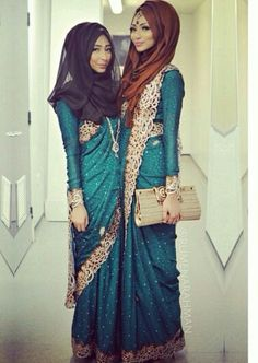 Love the hijabi sari, not to sure about the colours of the actual scarves????