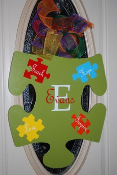 Autism Awareness Door Hanger. I think Hobby Lobby Sells these big wooden puzzle pieces.