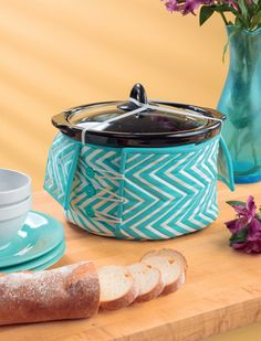 Cool slow-cooker cozy holds the lid in place and prevents burnt fingers during serving or transport. Designed by Rebecca Silbaugh for the book Kitchen Stitches.