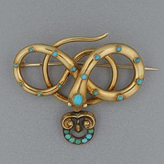A mid Victorian serpent brooch Intertwined collet-set with turquoise and with a pendant drop below.