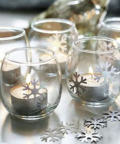 9 Homemade Holiday and Christmas Decorations Frosty Lights - Want to create a tabletop winter wonderland? Add snowflake stickers to clear glass votives and sprinkle them along your tablescape. Winter Wonderland Decorations, Winter Wonderland Theme, Winter Wonderland Christmas, Wonderland Party, Winter Christmas, Winter Decorations, Simple Christmas, Diy Snowflake Decorations, Minimal Christmas