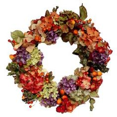"Faux hydrangea and berries wreath.   Product: Faux floral wreathConstruction Material: Polyester and plasticColor: MultiDimensions: 22"" Diameter x 6"" D"