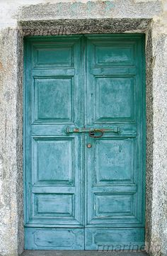 Old turquoise door in Italy.