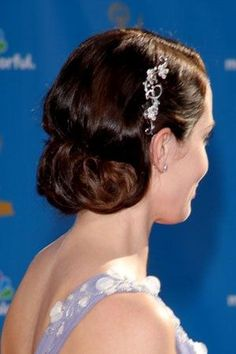 Hair Ideas: Vintage-Inspired Hair Accessories -- Emily Blunt (above) clipped back one side of her hair with a silver barrette of flowers and vines | allure.com