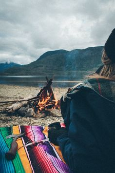 Mexican blanket, campfire, view.... I bet there is a Stout Tent Bell Tent behind her. #stouttent #belltent - www.wetravelandblog.com for your wanderlust fill!    #acampinglife