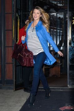 Blake Lively looking adorable in jeans, a striped tee, and blue coat