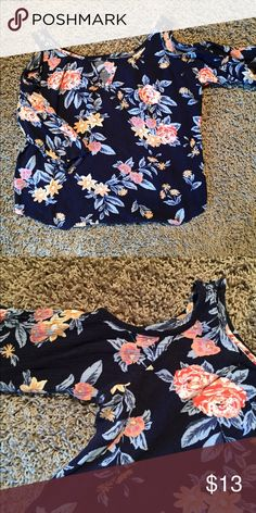 Cold Shoulders Floral Top This navy open shoulder blouse boasts a bold floral print. Think straps lead to a pep hole neckline. ****Size is a medium but fits like a small***** Charlotte Russe Tops Blouses