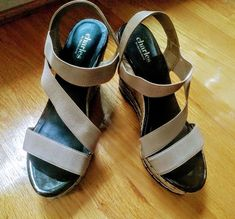 e9c4b2dd13fd57 Beige wedge with black sole of the shoe. Worn All elastic band except the  back strap.