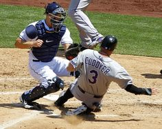 Game #32 5/9/12: Padres Nick Hundley puts the tag on Rockies Michael Cuddyer in the 4th inning on a Jason Giambi double. [K.C. Alfred U-T]