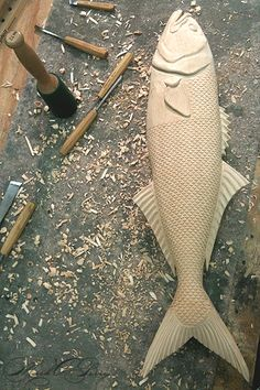 A work in progress by sculptor Mark A. Perry. Carving countless tiny scales on a bluefish.