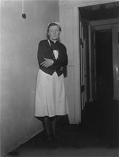 Irmgard Huber, chief nurse at Hadamar Institute, poses in the corridor of the euthanasia facility