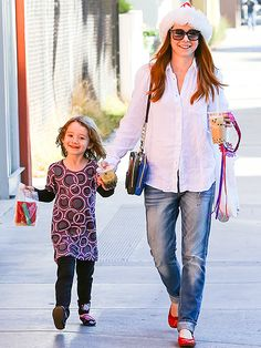 Alyson Hannigan and 4-year-old daughter Satyana stop by Santa Monica's Infuzion Cafe on December 26, 2013.