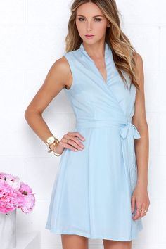 Lulus Exclusive! Sophistication begins by simply shrouding yourself in the chic Sartorial Splendor Light Blue Wrap Dress! Medium-weight woven poly fabric creates a sleeveless and darted, surplice bodice that fastens with a hidden button and adjacent wrapping sash tie. A full pleated skirt splays out from beneath the cinched, fitted waist. Fully lined.100% Polyester. Hand Wash Cold.