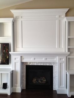 "DIY built-in fireplace surround using White1""x1"" Mother of Pearl tiles. Gorgeous!! https://www.subwaytileoutlet.com/products/White-1x1-Pearl-Shell-Tile.html#.VOUCuPnF-1U FIREPLACE"