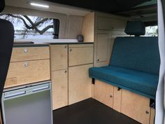 Our latest Van Conversion with a blue rock and roll bed, timber cabinetry with a white benchtop and sand carpet. Vw Campervans For Sale, Van Conversion Campervan, Rock And Roll Bed, Used Hyundai, Portable Solar Panels, Dinosaur Design, Car Wrap, Leather Design, Camper Van