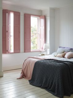 Pink solid-panel shutters give this pretty bedroom design a restful feel. http://www.theshutterstore.com