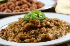 A North Indian dish, baingan bharta is an exotic combination of roasted eggplants and spices. The characteristic aroma of roasted eggplants blended with the spices makes this dish an irresistible preparation. It is eaten as a part of main course and tastes best with chapattis or parathas. This recipe was written by the Healthline Editorial Team:  http://www.healthline.com/health-recipes/baingan-bharta