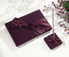 For Your Plum Wedding Reception Decor - Plum Satin Guest Book with Pen Set. www.ceceliasbestwishes.com