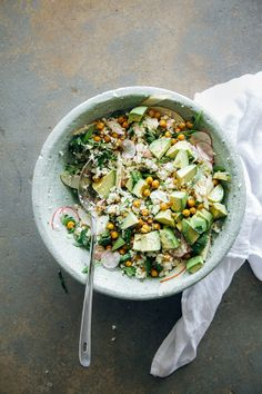 "Cauliflower and roasted garbanzo ""rice & peas"" with avocado, apples, herbs etc. from The First Mess"