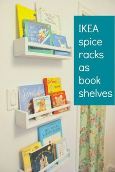 Using IKEA spice racks as bookshelves in a nursery. Great way to have outward facing storage for board books!