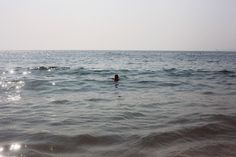 Girl alone in the water.