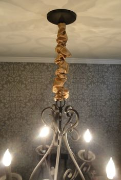 Make your own chandelier chain cover. It looks WAY better than the ...