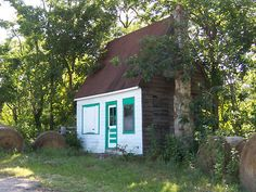 An old cottage style gas station located just east of Marshfield, Missouri. That town is the birthplace of Dr. Edwin Hubble, astronomer and namesake of the Hubble Space Telescope.