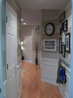 Those stripes are awesome and I love those square things in white. I don't know what to call it, wainscoting??!!