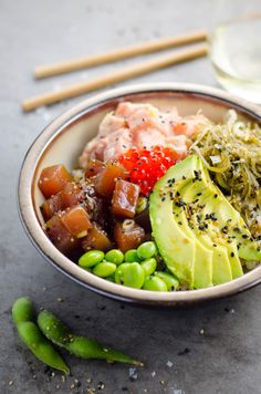 A healthy and delicious brown rice poke bowl with ahi tuna, spicy salmon, avocado, edamame, seaweed salad Salmon Recipes, Fish Recipes, Seafood Recipes, Asian Recipes, Healthy Recipes, Healthy Foods, Asian Foods, Healthy Cooking, Healthy Skin