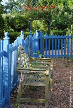 Blue garden fence. Kitchen Garden at Sir Roy Strong's The Laskett Gardens, Herefordshire, England. (www.thelaskettgardens.co.uk)
