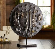 This is a cool looking jewelry #organizing option! Antiquities Disk Jewelry Stand