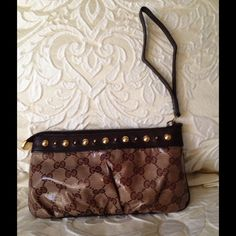 Authentic Gucci Wristlet Like new condition. Used as a cosmetic case in side my matching handbag. No scratches or signs of wear. Gucci Bags Cosmetic Bags & Cases