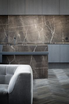 Kitchen in Moon Grey Stone by Arjaan De Feyter - Picture by Thomas De Bruyne - Execution Graniet & marmer