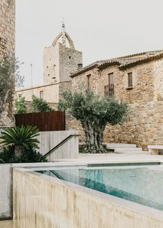 """in the county of Baix Empordà in Spain, the small Catalan village of Peratallada boasts a new landscape project designed by the Barcelona- based architecture studio MESURA. Peratallada —whose name derives from the phrase """"pedra tallada"""", carved stone— is one of the most famous fortified villages in Spain, built around a medieval castle made up of several buildings sharing a common courtyard."""