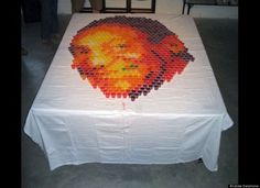 """Artist Andrew Salamone decided to celebrate Bill Cosby\'s birthday in 2009 with, what else, a portrait of the comedian in Jell-O shots!"" via huff post"