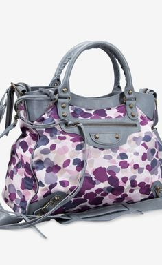 Brighten up that black suit with Investment handbag! contemporary pattern and color palate. #handbag #accessories
