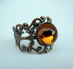 Victorian Style Antiqued Bronze Adjustable Filigree Ring with Topaz Glass Caboch $10.00