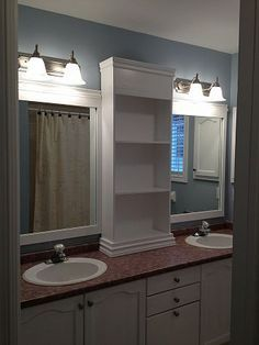revamp large bathroom mirror - frame with a shelf down the middle - master bath