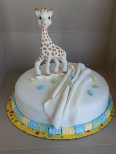 I made this Simple baby shower cake for my son's best friend. Sophie the Giraffe non-toxic baby teether topper.