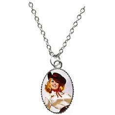 Lavishy Happy Go Lucky Western Pin-up Girl Pendant Necklace. Lavishy's Western Cowgirl Happy Go Lucky Pinup Necklace is from their new Pop Art collection. This dainty necklace is small and quirky. Designer stamped tag plate that reads LAVISHY. Silver-tone. Pendant measures .5 inches long. Lobster clasp. Handmade with metal and clear resin. Rhodium-plated, which prevents tarnishing. Hypoallergenic. Lead and nickel free.
