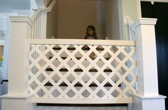 Baby Gate Made out of Sheet of Vinyl Trellis Covered with a Few Moldings on the Top and Bottom