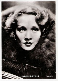 French postcard by Europe, no. 58. Photo: Paramount.   Marlene Dietrich (1901-1992) is regarded as the first German actress to become successful in Hollywood. Throughout her long career, she constantly re-invented herself, starting as a cabaret singer, chorus girl and film actress in 1920s Berlin, she became a Hollywood movie star in the 1930s, a World War II frontline entertainer, and finally an international stage show performer from the 1950s to the 1970s, eventually becoming one of the…