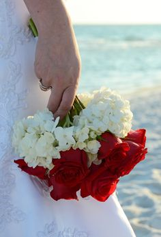 Red rose and white hydrangea bridal bouquet.  Photo by Sunset Beach Weddings
