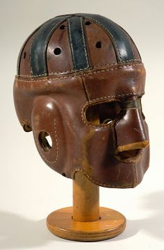 Circa 1920's full-face executioner style leather football helmet.