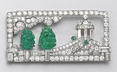 ART DECO CARVED EMERALD AND DIAMOND BROOCH, CIRCA 1925.  The rectangular plaque depicting a temple on a hill and two carved emerald trees under clouds in a landscape, set with baguette, small round and single-cut diamonds and accented with 2 small cabochon emeralds, mounted in platinum.