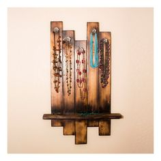 This rustic Jewelry Hanger is made with solid cedar, burned with an open flame and sealed with a high lustre gloss finish. This jewelry rack features 5 glass knobs to hang necklaces, bracelets, and other jewelry. Jewelry Hanger also has an accessory shelf to keep other items such as earrings, rings, and more.  This Jewelry Hanger comes mounting brackets pre-installed on back for easy hanging!