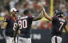 (Brett Coomer / Houston Chronicle) Texans quarterback Case Keenum (7) gets a hand from wide receiver Andre Johnson after throwing a touchdown pass.