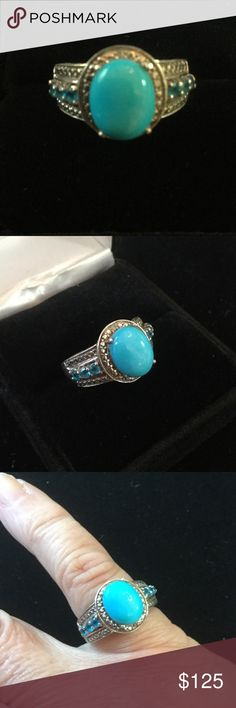 Sleeping Beauty Turquoise Ring I was told this was bought on QVC,  and was pricy.  This ring is set in .925 and accented wth Swiss blue topaz.  Beautiful and Hi quality this has some of the best turquoise in the west.  Turquoise is a timeless beauty ! QVC Jewelry Rings