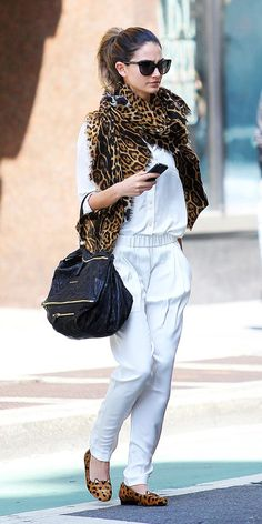 Lily Aldridge does white on white with a pop of leopard. #fashionweek #streetstyle