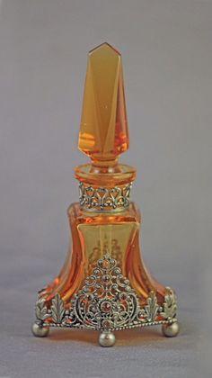 "Czechoslovakian perfume bottle, 1930's, 4 3/4"" tall, Vibrant deep amber glass…"